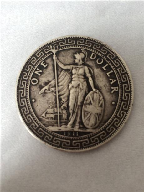 一枚家传的站洋银元能卖多少钱